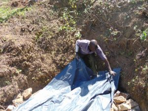 The Water Project:  Backfilling With Tarp