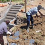 The Water Project: Elwichi Community, Mulunda Spring -  Backfilling With Soil