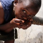 The Water Project: Elwichi Community, Mulunda Spring -  A Girl Drinks Water At The Spring