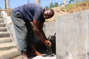 The Water Project:  Mark Wamondo Washing Hands