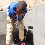 The Water Project: Elwichi Community, Mulunda Spring -  Victor Cooling Off
