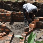 The Water Project: Isanjiro Community, Musambai Spring -  Wall Construction