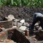 The Water Project: Isanjiro Community, Musambai Spring -  Stone Pitching