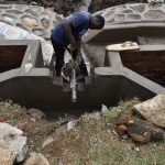 The Water Project: Isanjiro Community, Musambai Spring -  Pipe Setting