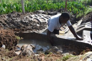 The Water Project:  Backfilling With Clay And Stones