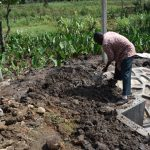 The Water Project: Isanjiro Community, Musambai Spring -  Backfilling With Soil