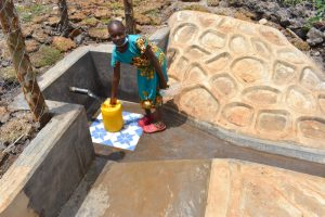 The Water Project:  Mercy Collecting Water