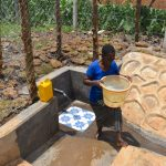 The Water Project: Isanjiro Community, Musambai Spring -  Mounting Water To Carry