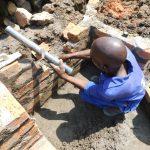 The Water Project: Mukoko Community, Zebedayo Mutsotsi Spring -  Pipe Setting