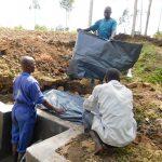 The Water Project: Mukoko Community, Zebedayo Mutsotsi Spring -  Backfilling With Tarp