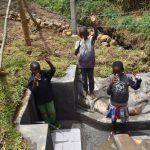 The Water Project: Mukoko Community, Zebedayo Mutsotsi Spring -  Children Drinking Clean Water
