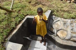 The Water Project:  Nelly Drinking Clean Water From The Spring