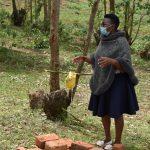 The Water Project: Mukoko Community, Zebedayo Mutsotsi Spring -  Facilitator Demonstrates Handwashing Using A Tippy Tap