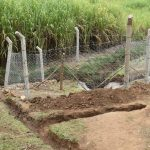 The Water Project: Mukoko Community, Zebedayo Mutsotsi Spring -  Fenced In Catchment Area With Cut Off Dainage Channels