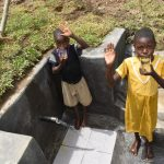 The Water Project: Mukoko Community, Zebedayo Mutsotsi Spring -  Taking A Drink From The Spring