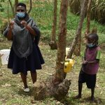 The Water Project: Mukoko Community, Zebedayo Mutsotsi Spring -  Young Fred Practices Handwashing With A Tippy Tap