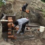 The Water Project: Mukhuyu Community, Gideon Kakai Chelagat Spring -  Wall Construction