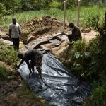 The Water Project: Mukhuyu Community, Gideon Kakai Chelagat Spring -  Backfilling With Tarp
