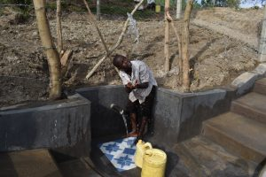 The Water Project:  A Boy Celebrating At The Spring