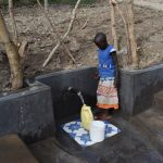 The Water Project: Mukhuyu Community, Gideon Kakai Chelagat Spring -  A Girl Fetching Water