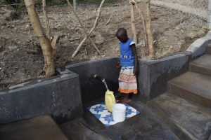 The Water Project:  A Girl Fetching Water