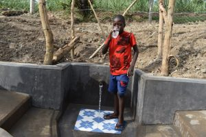 The Water Project:  Enoc Drinking Water From The Spring