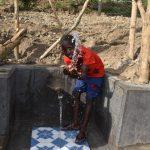 The Water Project: Mukhuyu Community, Gideon Kakai Chelagat Spring -  Enoc Splashing Water