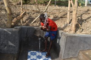 The Water Project:  Enoc Splashing Water