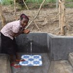 The Water Project: Mukhuyu Community, Gideon Kakai Chelagat Spring -  Drinking Water From The Spring