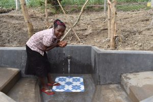 The Water Project:  Drinking Water From The Spring