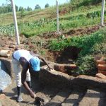 The Water Project: Shihome Community, Oloo Njinuli Spring -  Plastering