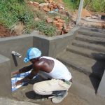 The Water Project: Shihome Community, Oloo Njinuli Spring -  Tiles Setting
