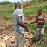 The Water Project: Shihome Community, Oloo Njinuli Spring -  Backfilling With Rocks