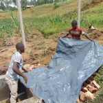 The Water Project: Shihome Community, Oloo Njinuli Spring -  Backfilling With Tarp