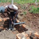 The Water Project: Shihome Community, Oloo Njinuli Spring -  Pipe Setting