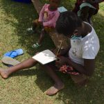 The Water Project: Shihome Community, Oloo Njinuli Spring -  A Community Member Taking Notes