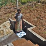 The Water Project: Shihome Community, Oloo Njinuli Spring -  Enjoying A Fresh Drink