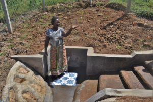 The Water Project:  Holding Up A Glass Of Clean Water
