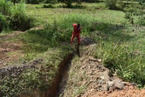 The Water Project:  Diggin Drainage Channel