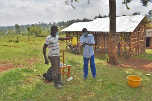 The Water Project:  A Community Member Demonstrates Handwashing