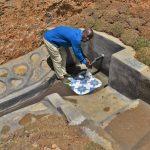 The Water Project: Shianda Commnity, Mukeya Spring -  Mr Mukeya Washing His Hands At The Spring