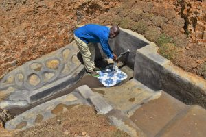 The Water Project:  Mr Mukeya Washing His Hands At The Spring