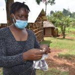 The Water Project: Shianda Commnity, Mukeya Spring -  Trainer Christine Demonstrates Mask Making
