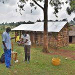 The Water Project: Shianda Commnity, Mukeya Spring -  Facilitator Shows Ten Steps Of Handwashing
