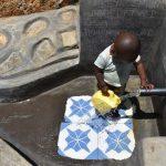 The Water Project: Shianda Commnity, Mukeya Spring -  Little Boy Fetching Water