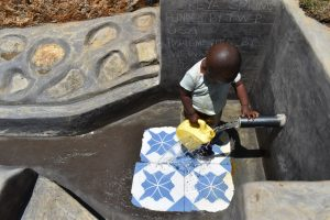 The Water Project:  Little Boy Fetching Water