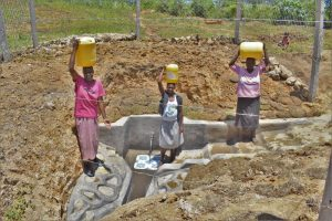 The Water Project:  Women Pose At The Spring