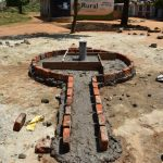 The Water Project: Ibokolo Primary School -  Set Structure Of A Borehole And Well Pad