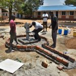 The Water Project: Ibokolo Primary School -  Testing Fit For Pump Head