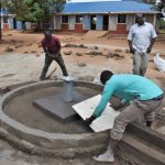 The Water Project: Ibokolo Primary School -  Affixing The Tile